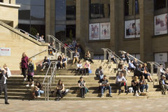 People relaxing next to Glasgow Royal Concert Hall royalty free stock image