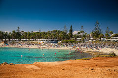 People relaxing at Nissi beach in Cyprus Stock Photo