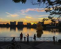 People are relaxing in the the Nong Prachak lake and enjoy with the big floating yellow rubber ducks balloon. UDONTHANI - THAILAND , JUN 18, 2016 : People are royalty free stock images