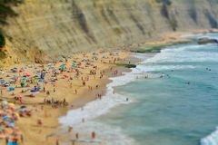 People relaxing On ocean portugal beach. Aerial View Of People Relaxing On Beach In Portugal stock photos