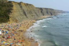 People relaxing On ocean portugal beach. Aerial View Of People Relaxing On Beach In Portugal royalty free stock images