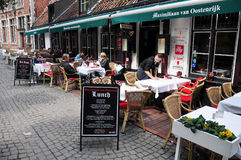 People relaxing at outdoor cafe, Bruges. Flanders, Belgium Royalty Free Stock Image