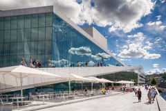 People relaxing in outdoor cafe at Oslo Opera House Royalty Free Stock Image
