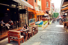 People relaxing at outdoor cafe in popular district of Kadikoy, Istanbul Stock Photos