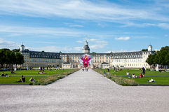 People relaxing by the palace in Karlsruhe, Stock Photography