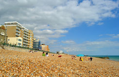 People relaxing on pebble beach in Brighton. Royalty Free Stock Photo