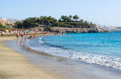 People relaxing on the picturesque El Duque beach Stock Photography