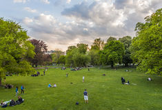 People are relaxing in public city park in Vienna, Austria Stock Images