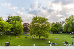 People are relaxing in public city park in Vienna, Austria Royalty Free Stock Photo