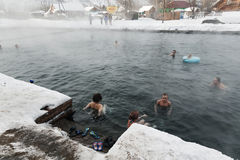 People relaxing in public geothermal spa in hot spring pool Stock Photo