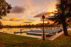 People relaxing in rowboats in the scenic pond of Buen Retiro Pa Royalty Free Stock Images