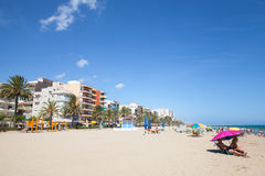 People relaxing on sandy beach of Calafell resort Stock Photography