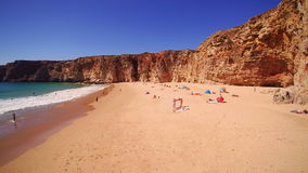 People relaxing by the seaside on the beach. Of Sagres, Algarve, Portugal stock video footage