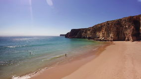 People relaxing by the seaside on the beach. Of Sagres, Algarve, Portugal stock footage