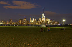 People relaxing in Sinatra Park, Hoboken. NJ with New York City skyline in background Royalty Free Stock Photography