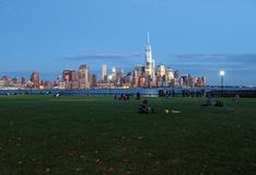 People relaxing in Sinatra Park, Hoboken. NJ with New York City skyline in background Stock Image