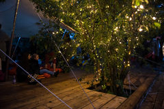 People relaxing in a special chilling natural area decorated wit