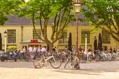 People relaxing on a sunny afternoon in front of a bar in Amster Royalty Free Stock Image