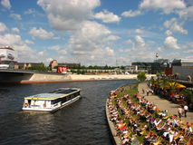 People relaxing  sunny day at river bank of spree Stock Photography