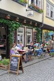 People have fun at a cosy terrace on the historic Merchants Bridge, Erfurt, Germany Stock Photos