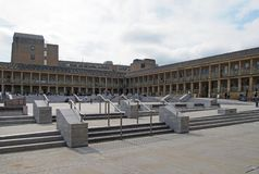 People relaxing in the town square around the piece hall in halifax west yorkshire. Halifax, west yorkshire, united kingdom - 31 may 2019: people relaxing in the stock image