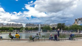 People relaxing in Tuileries Palace open air park near Louvre museum timelapse hyperlapse. Paris, France stock video footage