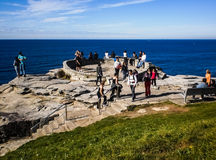 People relaxing at the view point of the sea. Royalty Free Stock Photo
