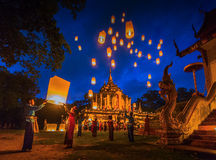 People release Khom Loi, the sky lanterns at Wat Phra Yuen. Lamphun, Thailand - December 6,2015 :Loy Khom festival in Lamphun.People release Khom Loi, the sky Stock Photo