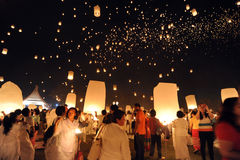 People release Khom Loi, the sky lanterns during Yi Peng or Loi Krathong festival. CHIANG MAI, THAILAND - November 24, 2012: People release Khom Loi, the sky Stock Image