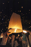 People release Khom Loi, the sky lanterns during Yi Peng or Loi Krathong festival Stock Photo