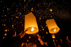 People release sky lanterns. CHIANGMAI, THAILAND - NOV 16: People release sky lanterns to worship Buddha's relics during Yi Peng festival on November 16, 2013 in Royalty Free Stock Photo
