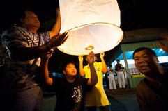 People release sky lanterns during the New Year celebrations Stock Image