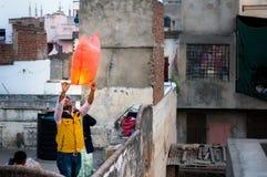 People releasing a chinese lantern in Jaipur Stock Image