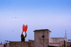 People releasing a chinese lantern in Jaipur royalty free stock image