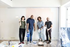 People renovating the house together royalty free stock photo