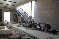 People repair escalator during construction on a way for metro station in subway in Sofia, Bulgaria – july 24, 2012. People repair escalator during Royalty Free Stock Images