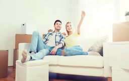 Couple with boxes moving to new home and dreaming. People, repair and real estate concept - smiling couple with boxes moving to new home and dreaming Royalty Free Stock Photography