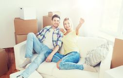 Couple with boxes moving to new home and dreaming. People, repair and real estate concept - smiling couple with boxes moving to new home and dreaming Stock Photo