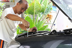 People are repairing cars. Stock Photos