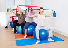 People with resistance bands sitting on fitness balls Royalty Free Stock Photos