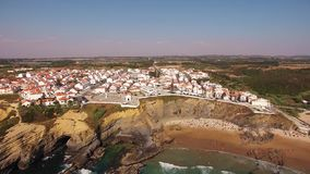 People rest on the beach naer Zambujeira de Mar, Portugal aerial view stock video