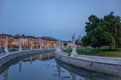 The central square of Prato della Valle in Padova, Italy, after sunset. People rest in the evening in the central square of Prato della Valle in the center of royalty free stock photo