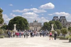 People rest at holiday vocations in park near Louvre palace at sunny day, Paris, France stock images