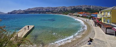 People rest on Laguna beach in the Historic Baska town on Krk Island on April 30, 2017. Croatia Royalty Free Stock Photo