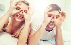 Happy couple lying in bed at home Royalty Free Stock Photos
