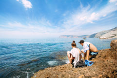 People rest near the sea Stock Images