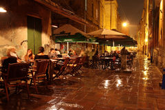 People rest in the outdoor bar at night Stock Photography