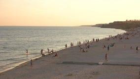 People rest on the sea. Evening sunset over the sea shore. Beautiful sea coast stock video footage