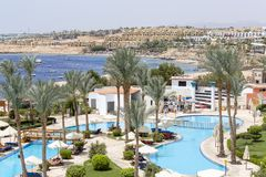 People rest in swimming pool near red sea in hotel, Sharm El Sheikh, Egypt stock photos