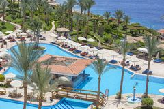 People rest in swimming pool near red sea in hotel, Sharm El Sheikh, Egypt stock photography